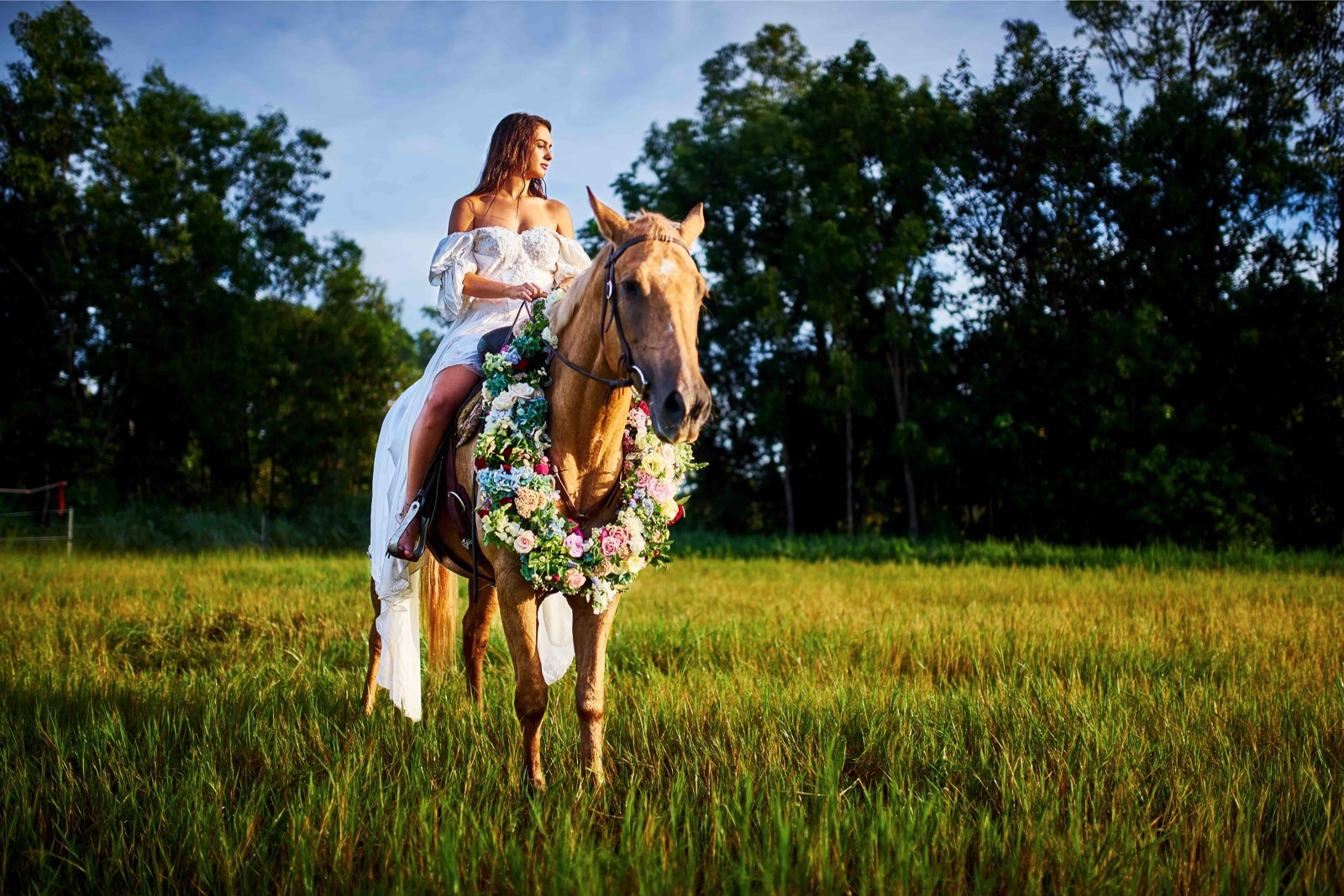 palomino pony wears beautiful floral garland in true Northern Territory wedding fashion
