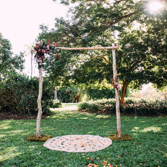rustic wedding arbour with native flowers for hire for Darwin Botanic Gardens wedding ceremony