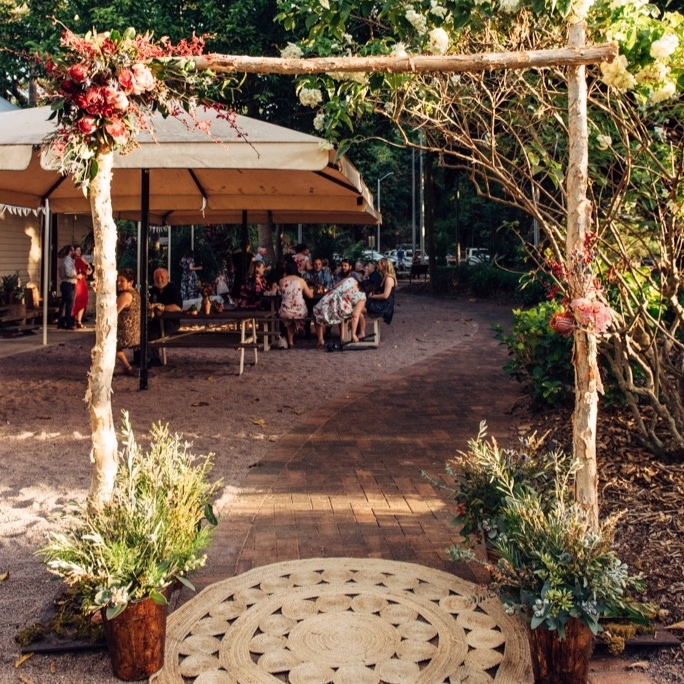 wedding ceremony arbor dressed with native flowers for hire from Darwin florist, Beija Flor