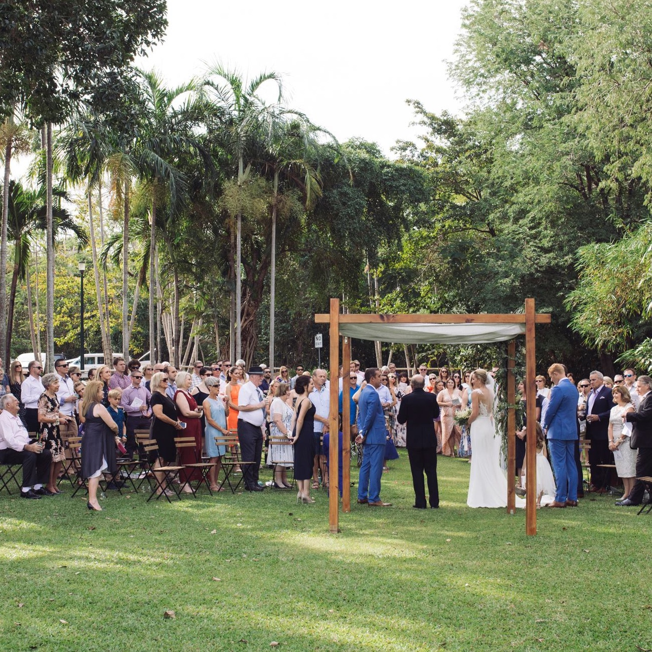 bride and groom are married under timber ceremony canopy in Darwin