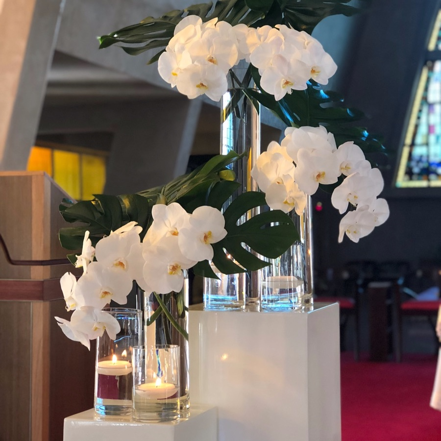 stylish white wedding ceremony flowers at Darwin cathedral