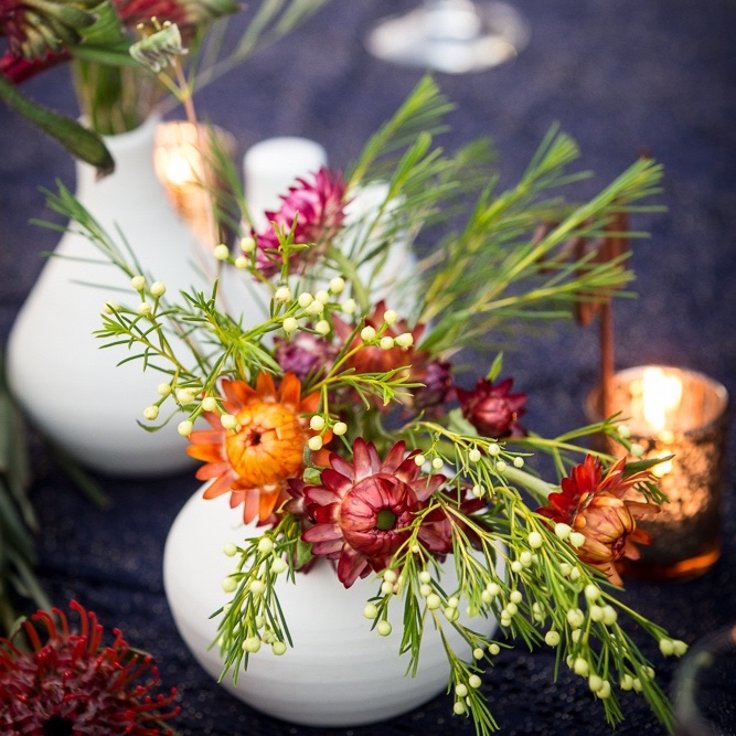 hand thrown vessels filled with colourful flowers for a gala event in Darwin