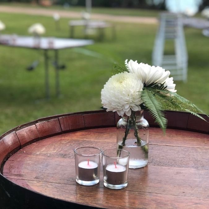 glass milk bottle vase filled with white chrysanthemums at a Darwin museum lawns wedding