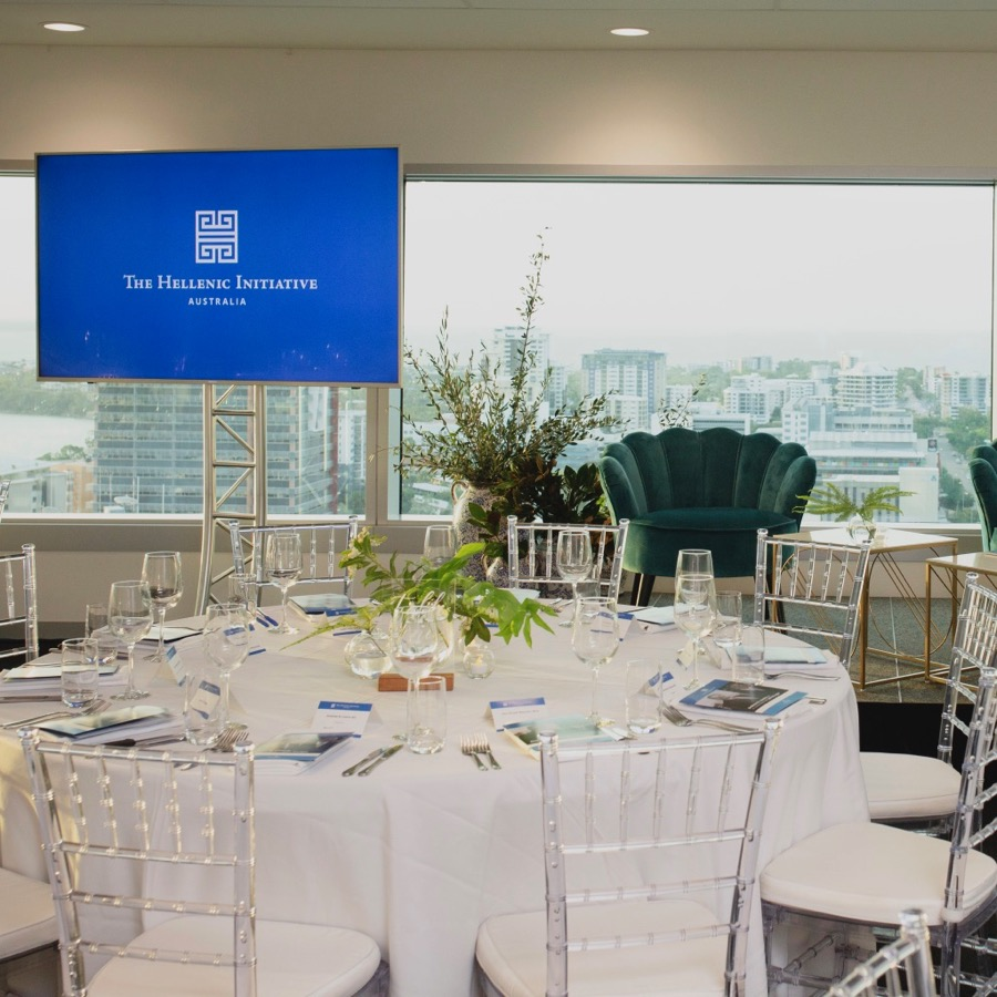 floral styling for a fundraising event held at Charles Darwin Centre, with spectacular views of Darwin city. Large blue and white vase topped with olive branch adorned the stage for this event.