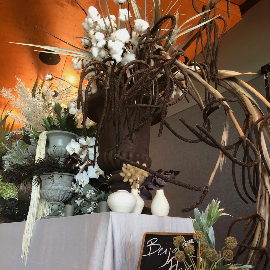 collection of rust patina and stone urns for floral styling in Darwin and Northern Territory from Darwin florist, Beija Flor