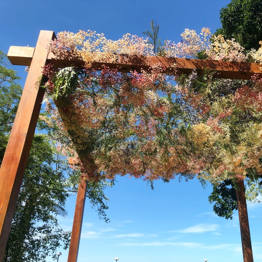 timber arbour with floral canopy of fresh tinted gypsophila (babies breath), large scale floral installations in Darwin, NT by florist, Beija Flor
