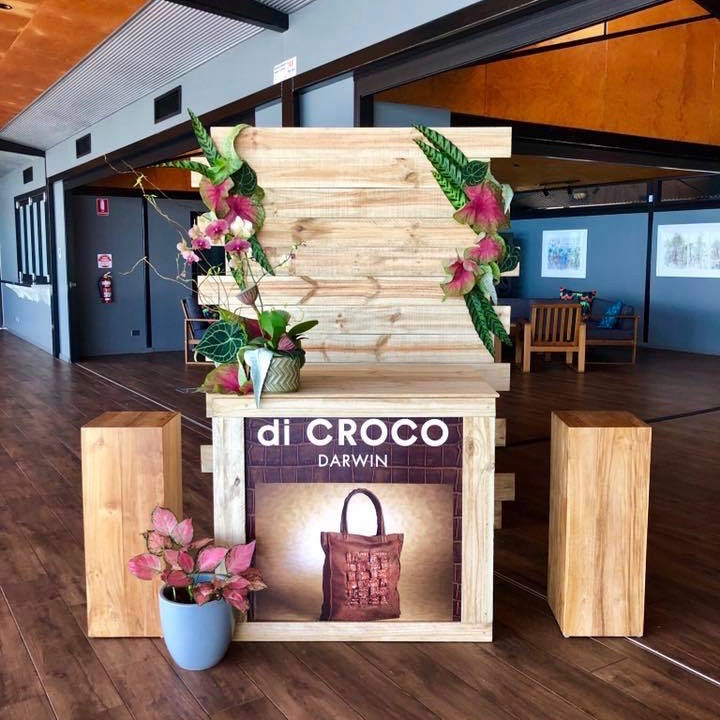 floral styling for Darwin brand, di Croco, using tropical leaves and timber pillars, at Pee Wees in Darwin