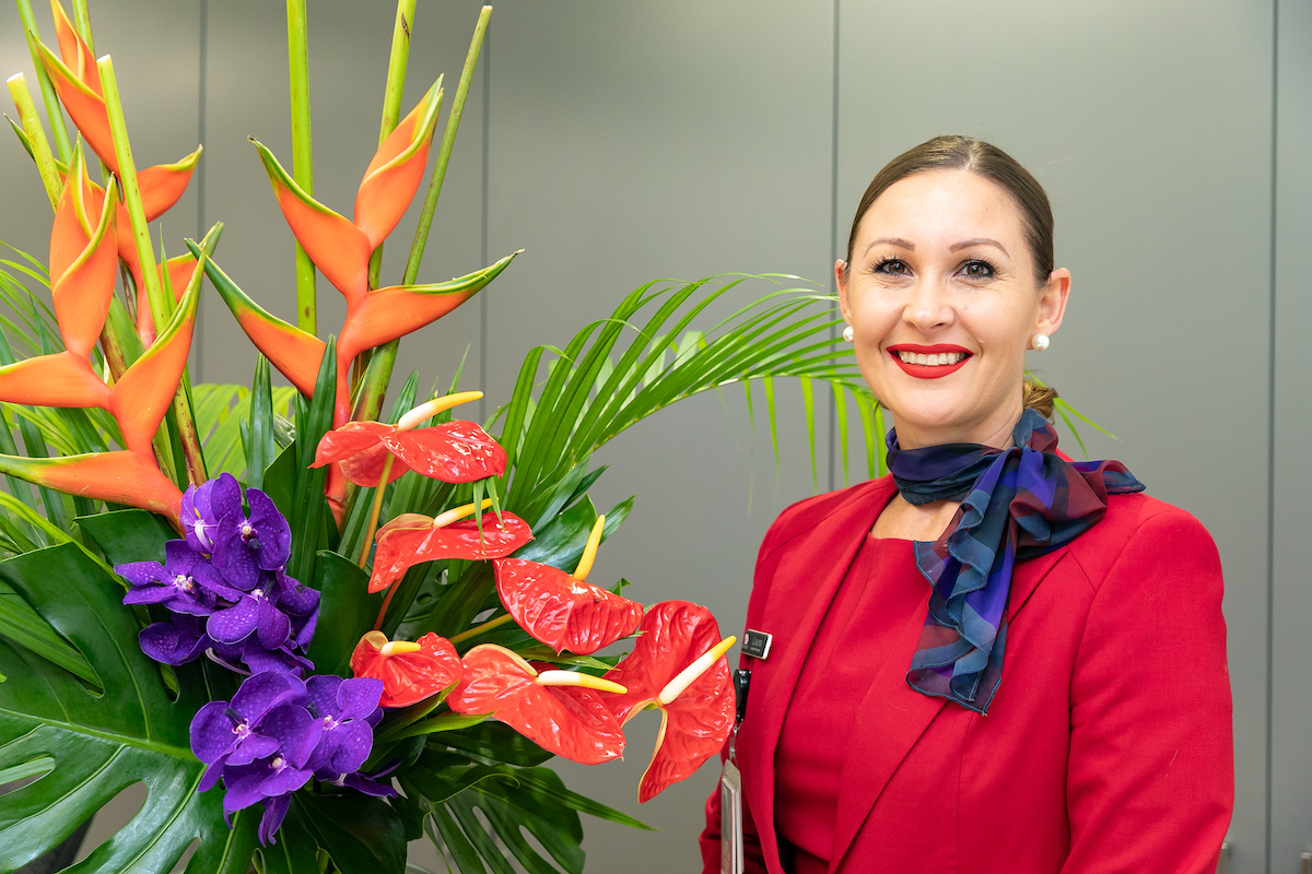 Red and purple tropical flowers complement Virgin branding.