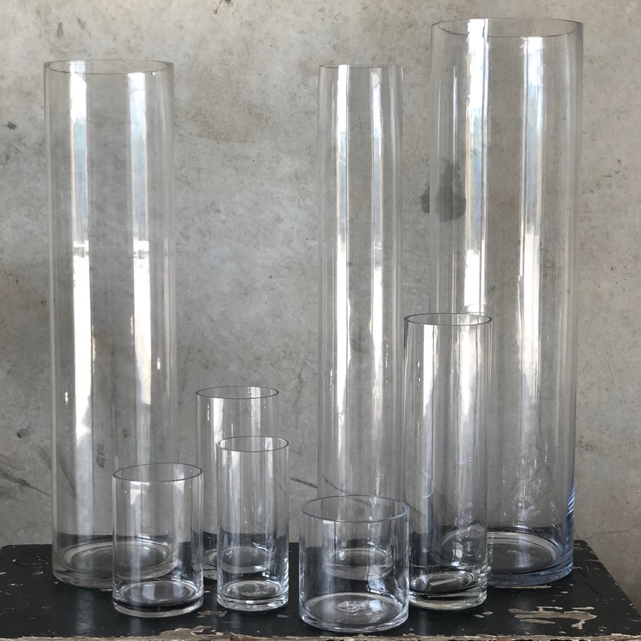 Range of glass cylinder vases, huge and smaller, suitable for submerged flowers or floating candles or pillar candles