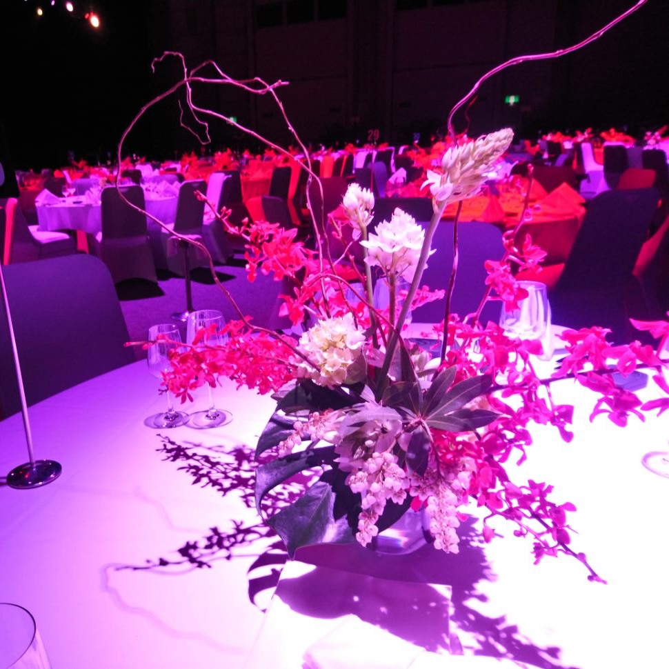 Corporate event flower centrepieces for Inpex event at Darwin Convention Centre.