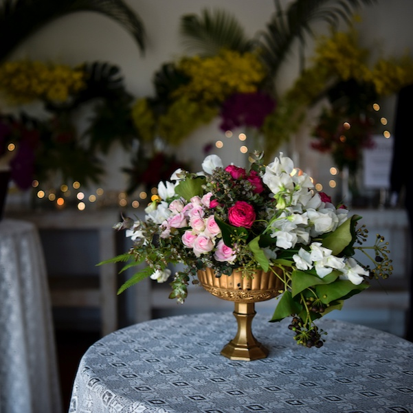 Fresh flower filled centrepieces in gold bowls
