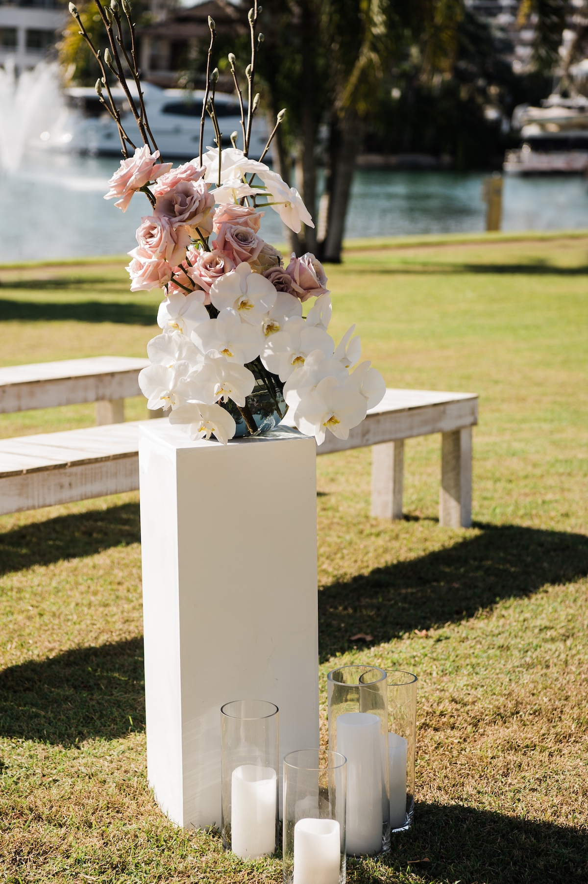 wedding ceremony entrance flowers with candles