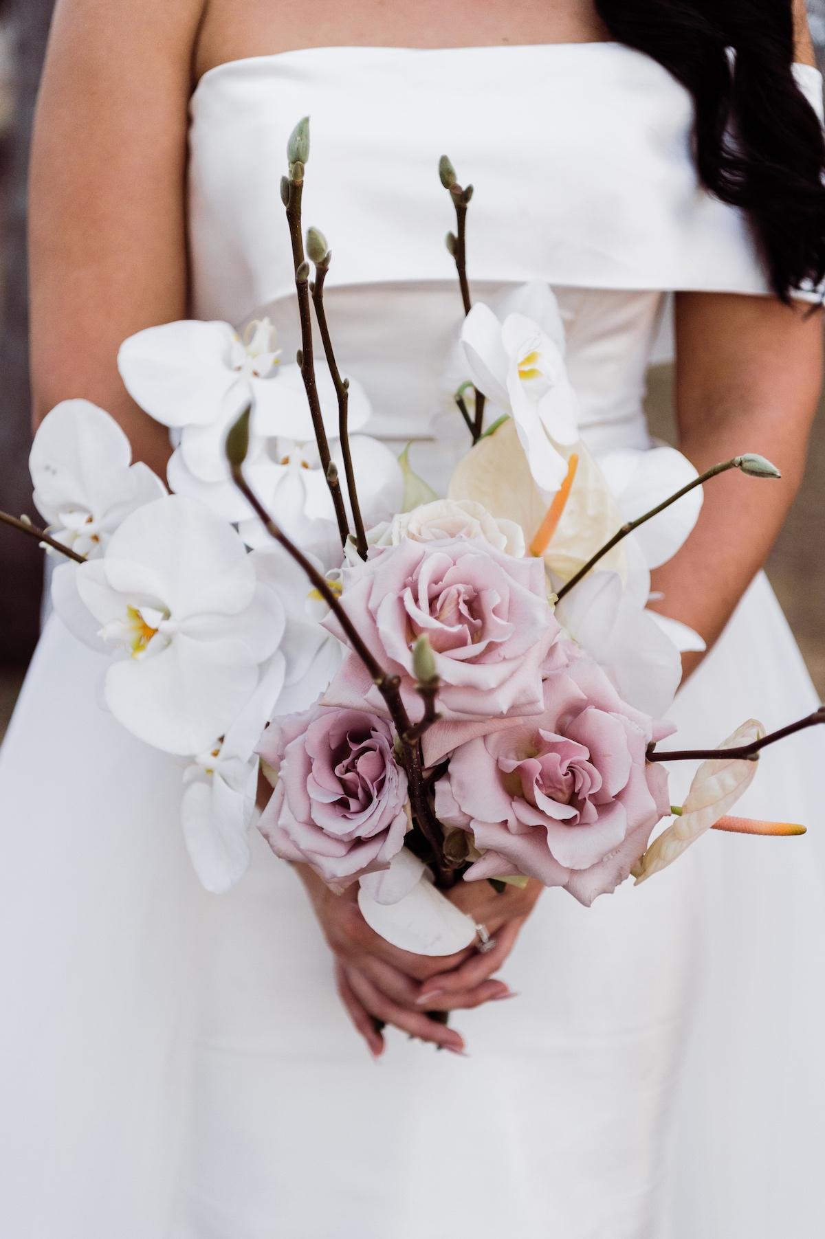 brides bouquet of orchids, anthuriums and phalenopsis orchids