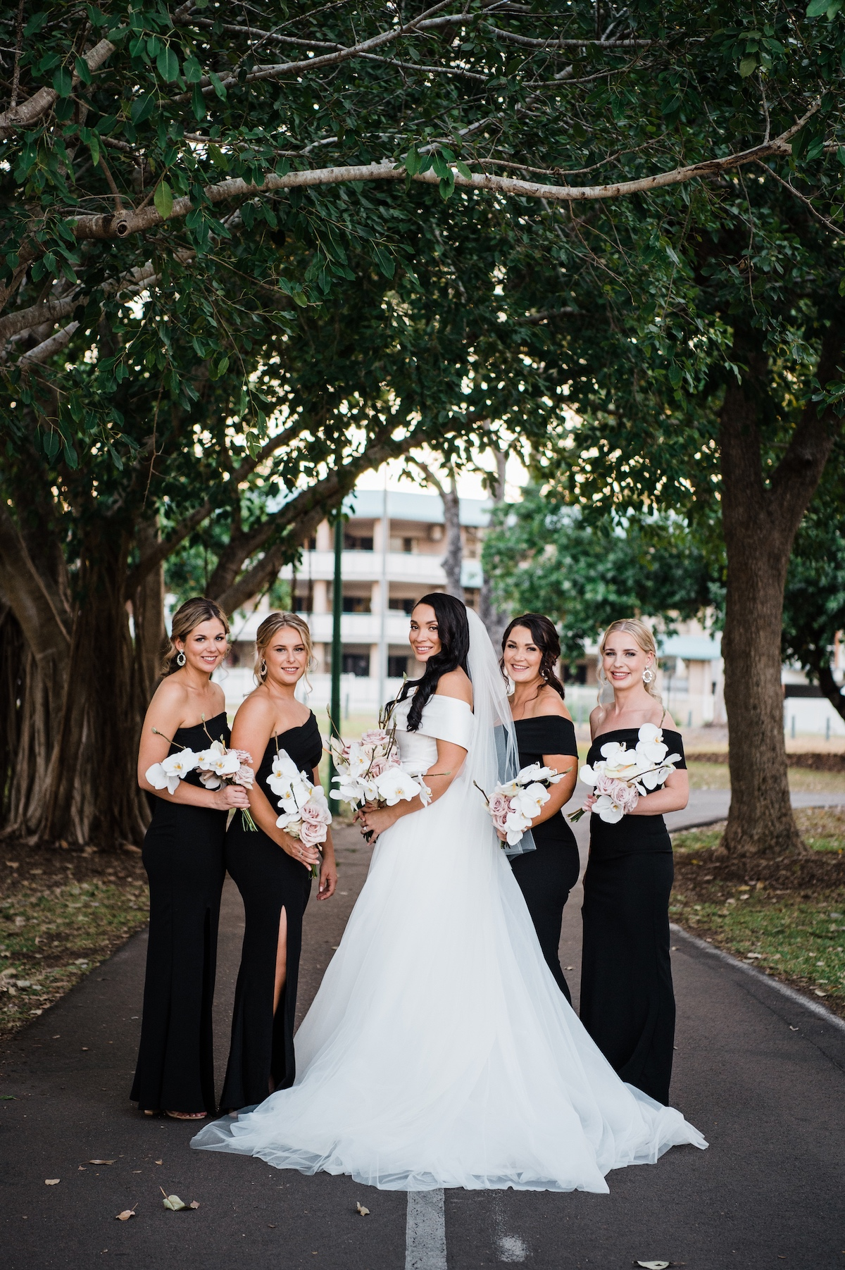 bride and bridesmaids with phalenopsis orchid bouquets