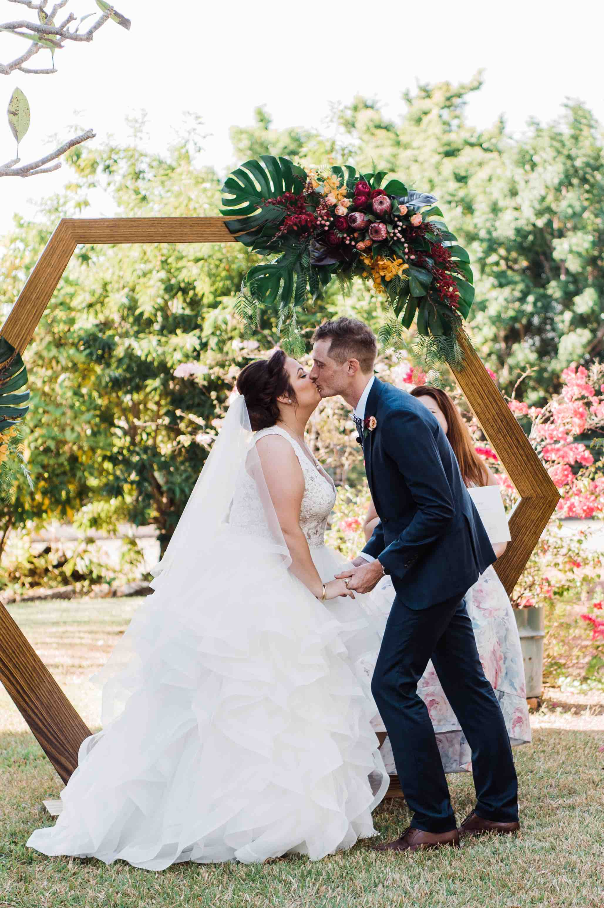 Wedding ceremony hexagon backdrop with floral