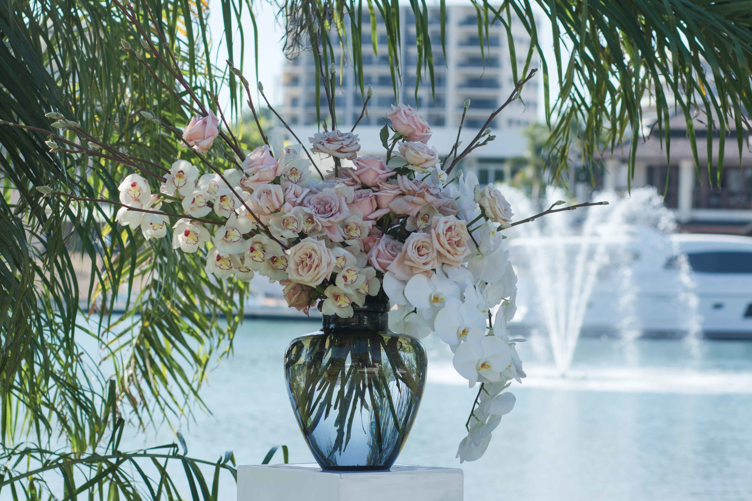 Copy of smoke glass vase filled with orchids and roses at Darwins, Cullen Bay Marina
