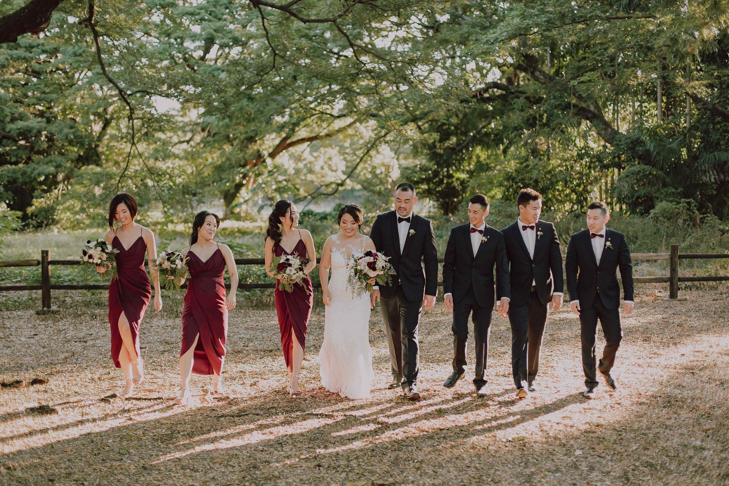 Wedding party in burgundy at Darwin Botanic Gardens