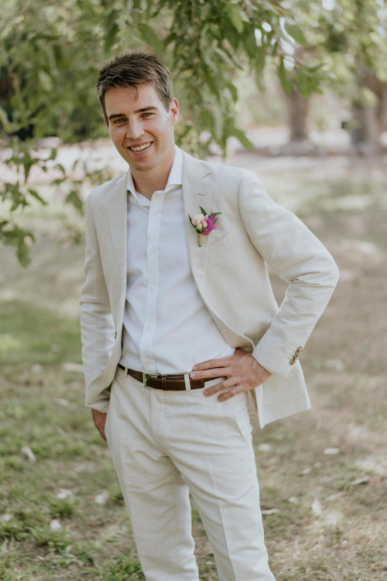 Groom wears Beija Flor buttonhole, photo by James Day