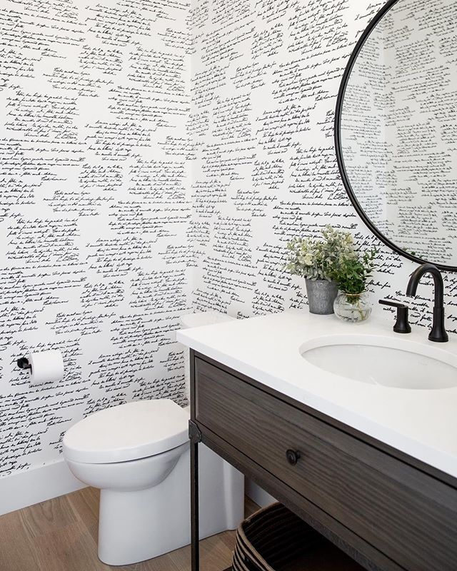 A busy print done right can add a touch of sophistication and character to a space. We're loving the monotone look of this bathroom! #DWKinteriors