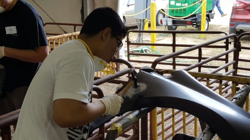 Student works on a competition project at the VA State Fair.
