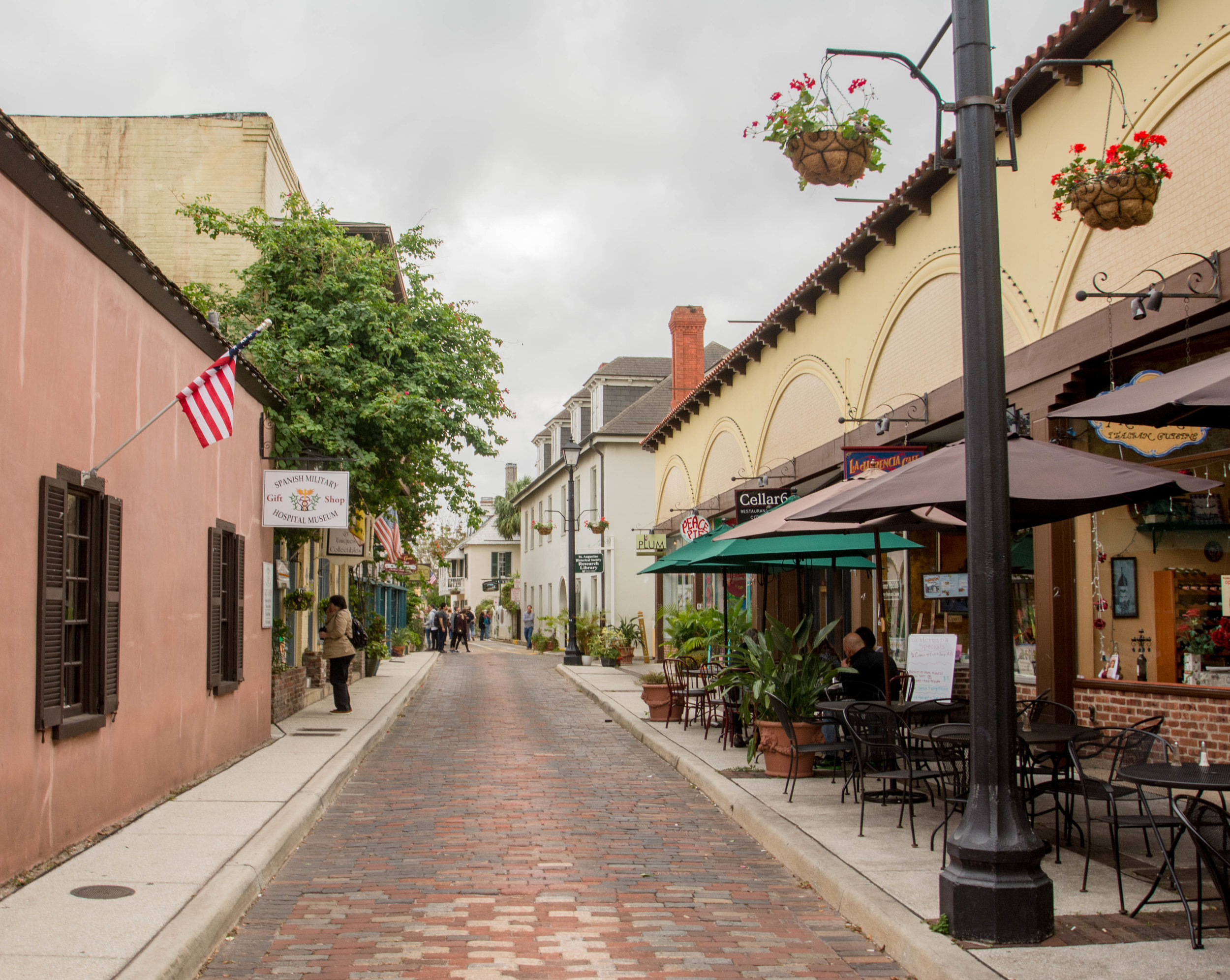 A stark contrast to State Road A1A, the streets in St. Augustine's historic center boast greenery, sidewalk cafes, brick roads, and ample shops.