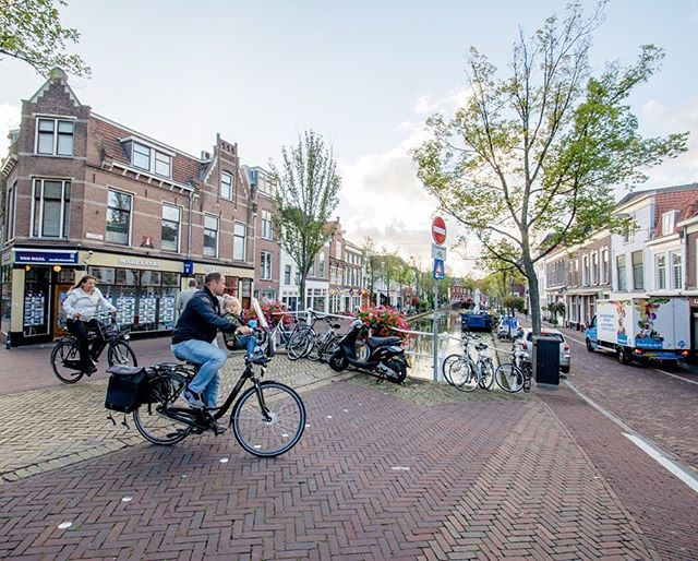 Roads in the historic town of Delft reflect the mobility hierarchy—bicycles first—of the greater transportation network of cities and towns in the Netherlands. Universally, red asphalt roads indicate bicycle traffic, whether on dedicated bicycle tracks or, in many cases, the entirety of the right-of-way.