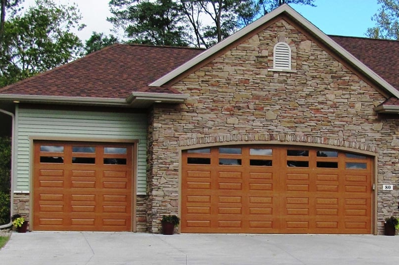 Fiberglass Doors. Our fiberglass doors look like wood garage doors but offer lower maintenance.