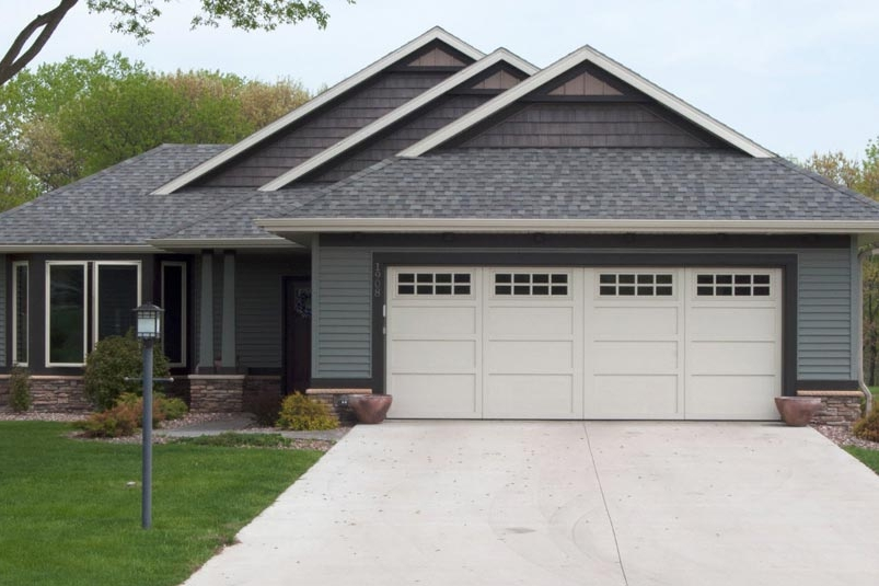 Courtyard Collection. Insulted steel garage doors made to resemble a hand crafted wood garage door.
