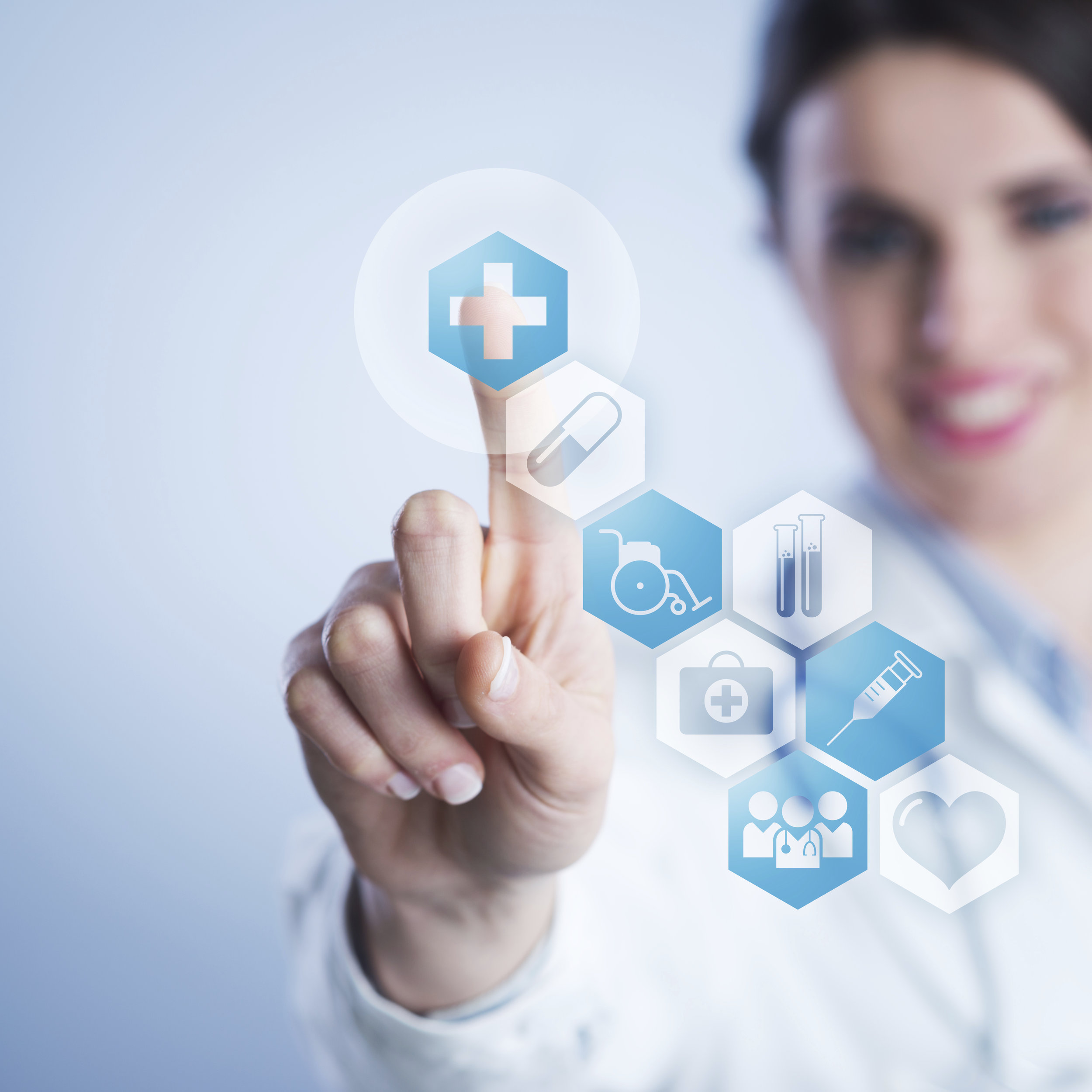 Young-female-doctor-using-touch-screen-interface-000038954294_XXXLarge.jpg
