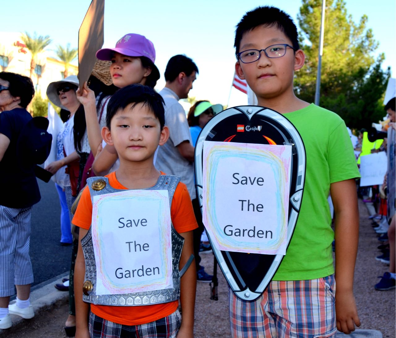 Yuxuan Deng and his young brother Ryan Deng at the protest against demolition of Chinese Cultural Center on August 20, 2017