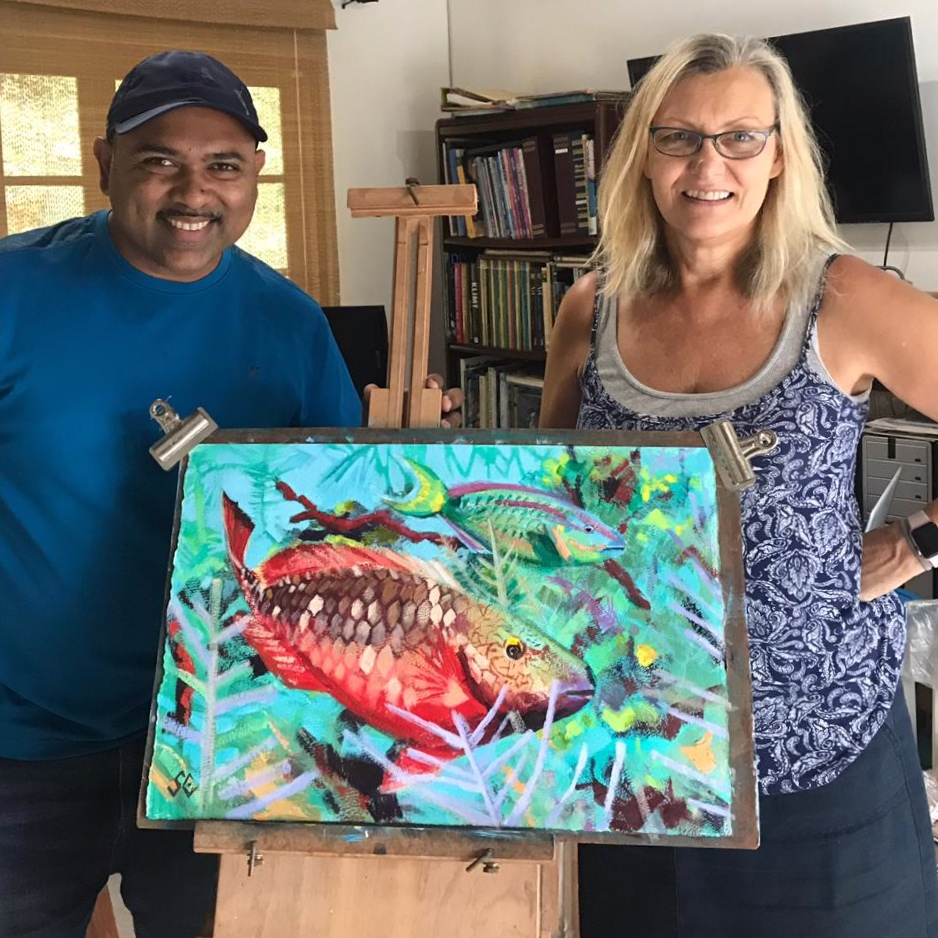 Stoplight Parrotfish painting in my studio with the photographer, Dr Dayne Buddo, marine scientist.