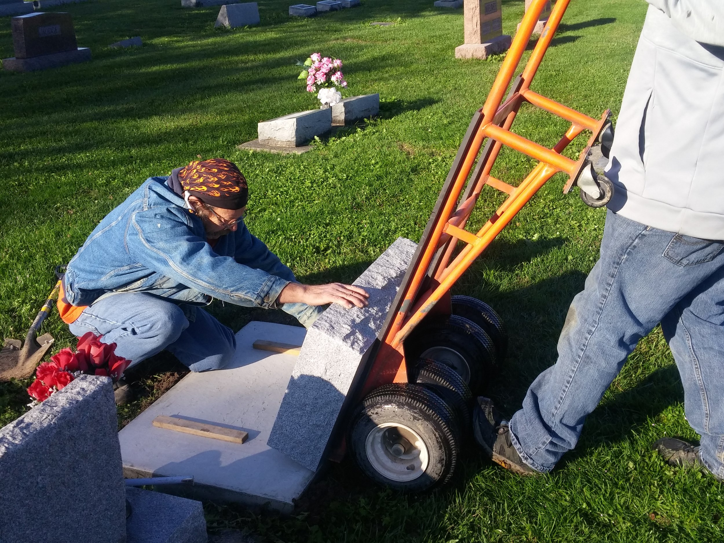 Moving monument base off of cart and onto the foundation