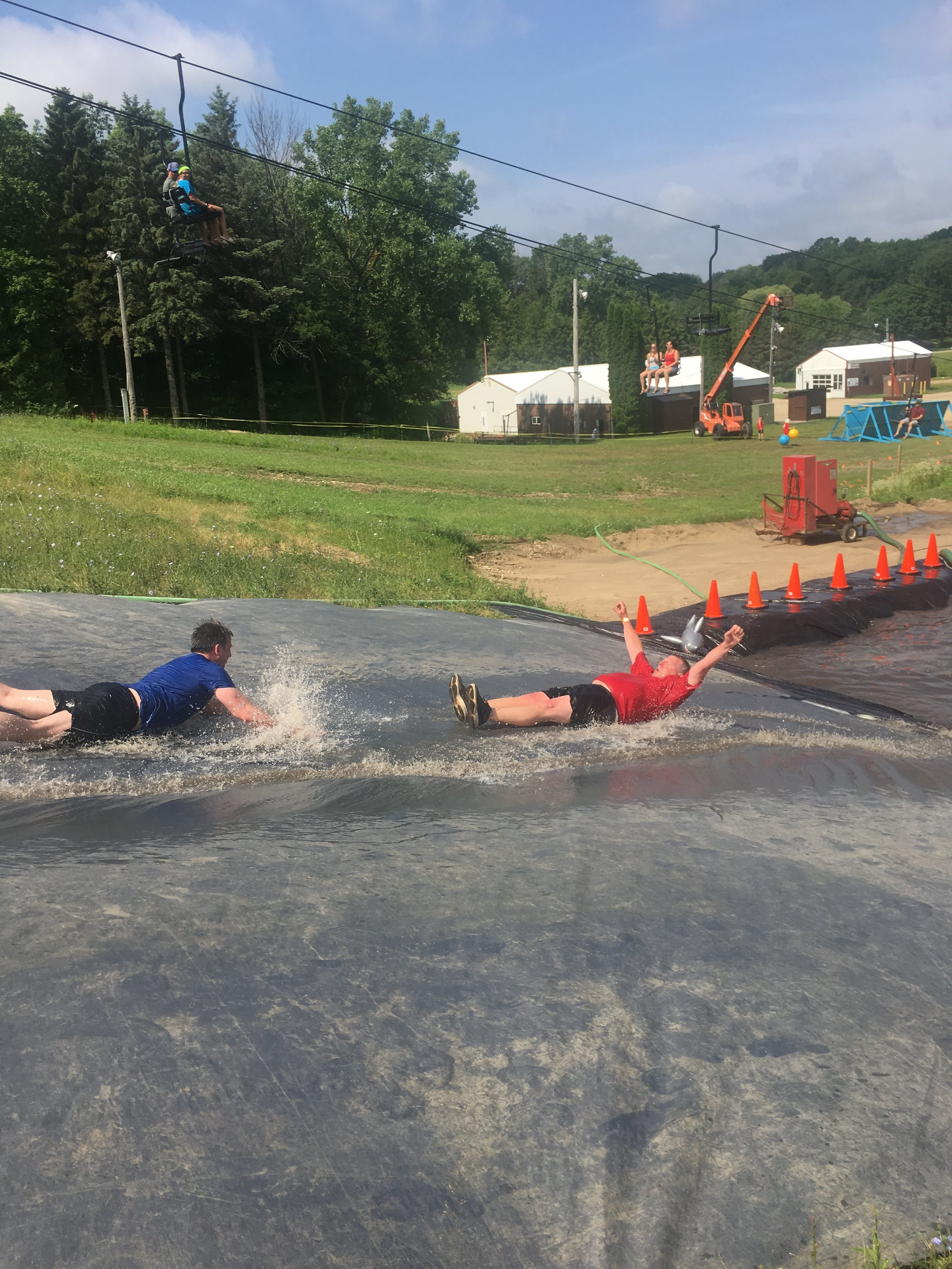Tim sliding into the finish line at the 2019 Mud Run