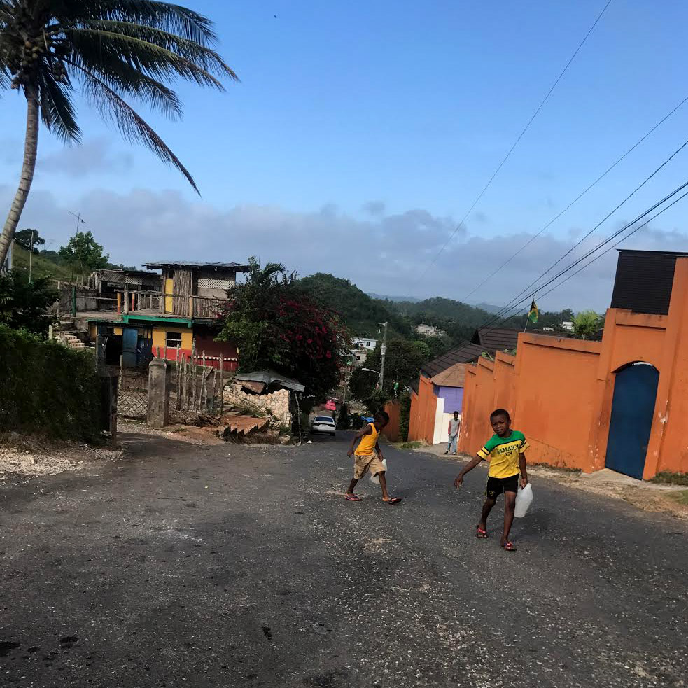 In Nine Mile, a remote mountain village of Jamaica, young children and the elderly are tasked with carrying water from the run-off water source to their homes.