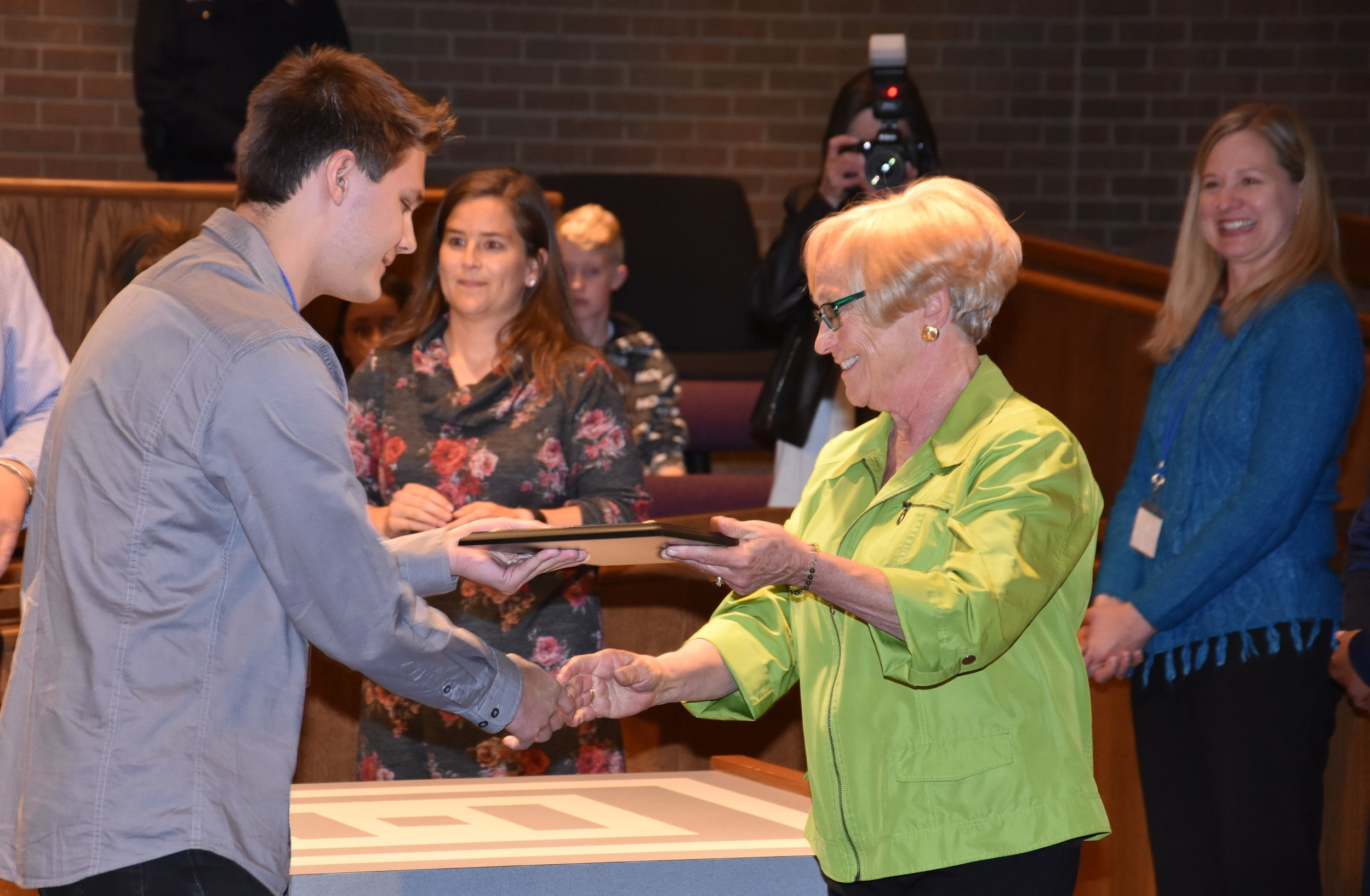 Logan Butler receiving the 2nd Annual Jim Glasmann Memorial Scholarship from Nancy of the Northey Board of Directors