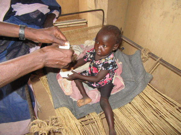 A-severely-malnourished-child-receives-a-BP-5-biscuit.-600x450.jpg