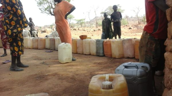Jerry-cans-lined-up-to-be-filled-at-a-repaired-Nuba-borehole-600x338.jpg
