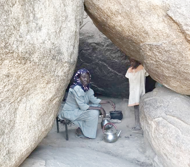 Mariam making tea in her cave home.