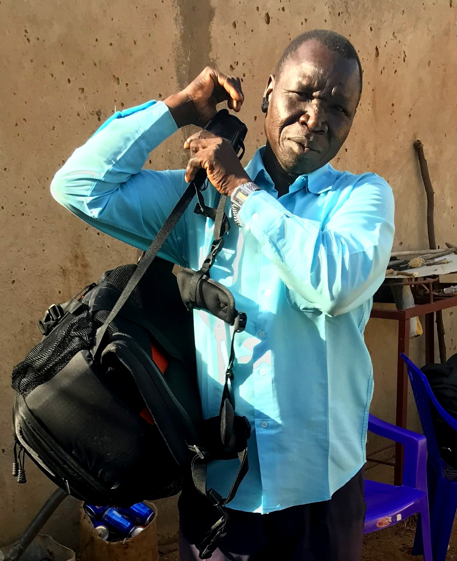 Pastor Matta with backpack projectors and audio Bibles.jpg