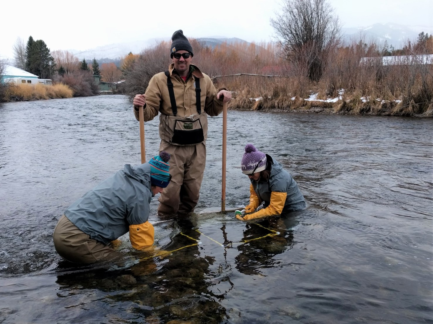Heidi Bellorado, Brooke Stallings, and Brenner Perryman from Alder Environmental collect samples.
