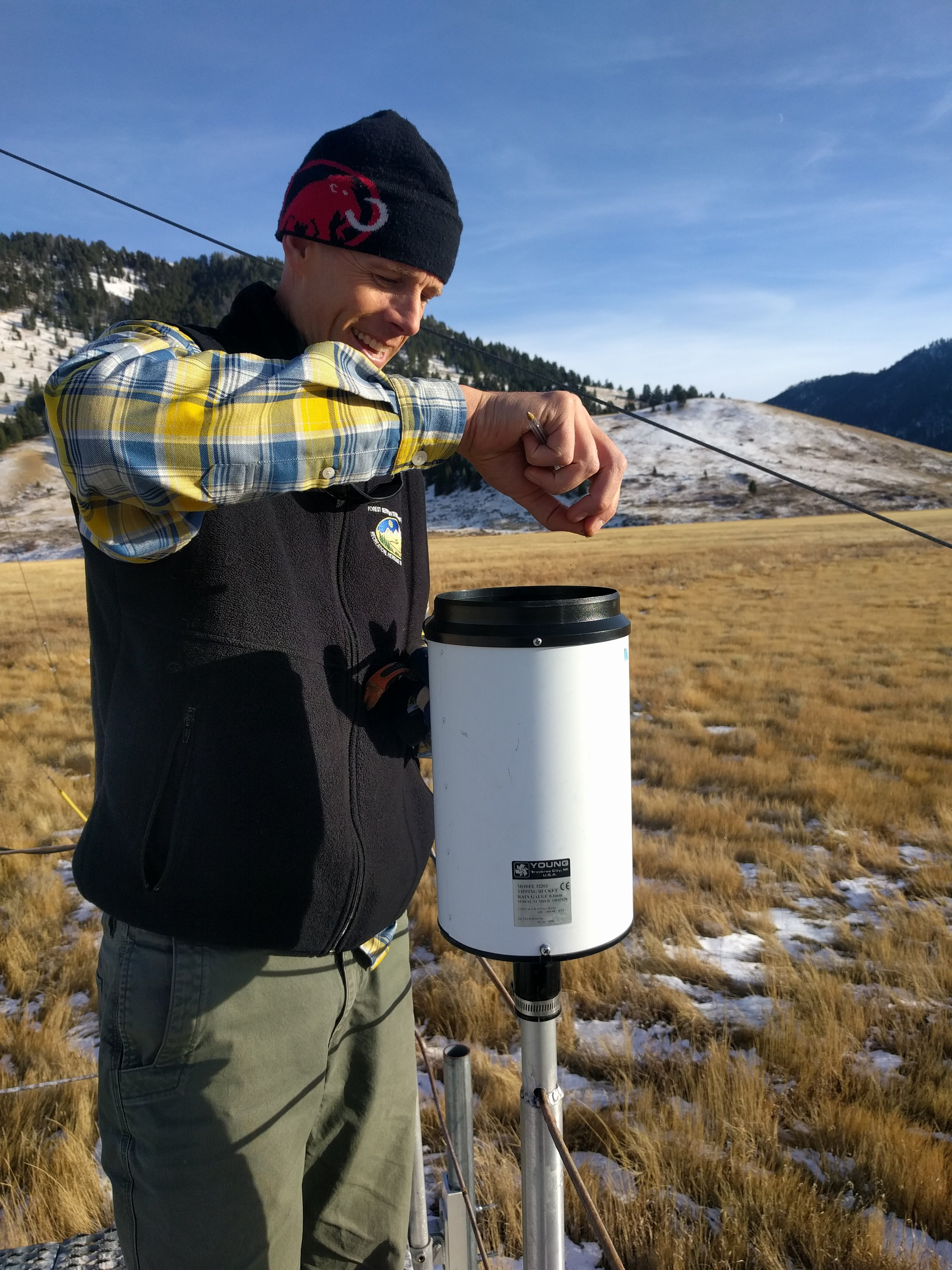 Robb removing bird droppings from the rain gauge.