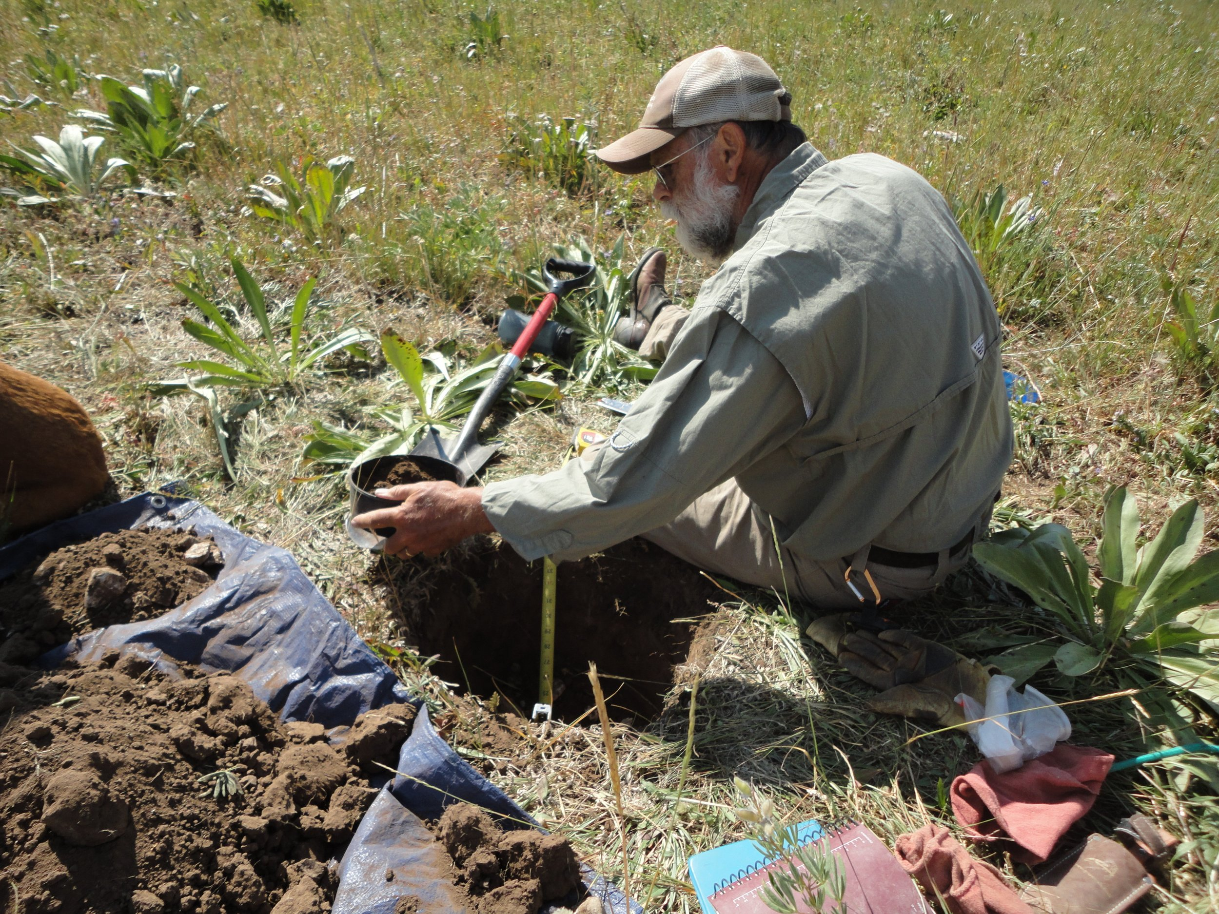 Chuck Butterfield, PhD with Y2 Consultants characterizes a soil pit during rangeland monitoring. Photo credit: Robb Sgroi