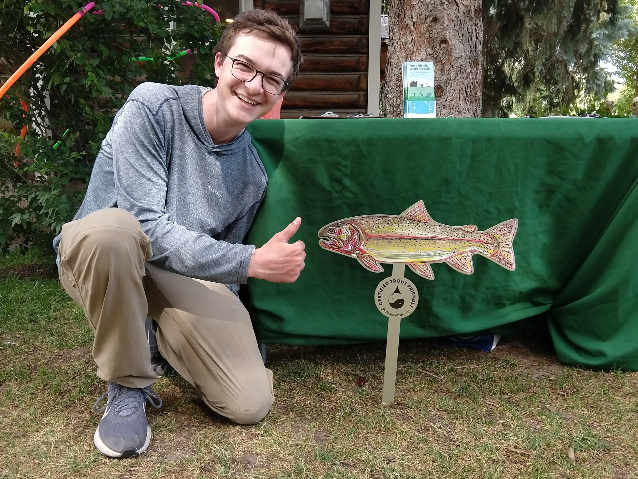 "Robert with a ""Trout Friendly Certified"" lawn sign.  Click here to certify your lawn and learn about your eligibility for a sign."