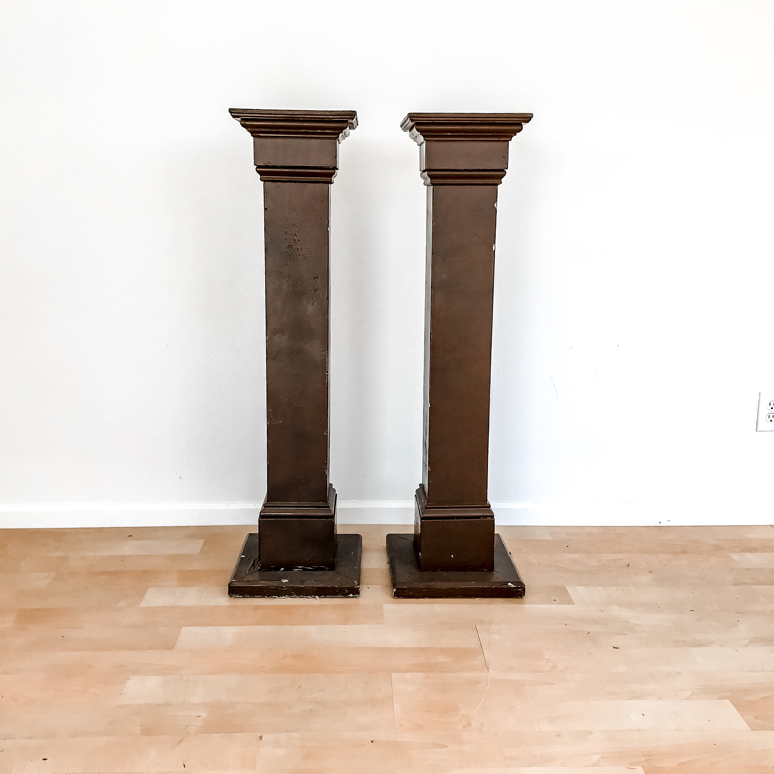 renee landry events  tall wood column pedestal stand decor wedding rentals.jpg