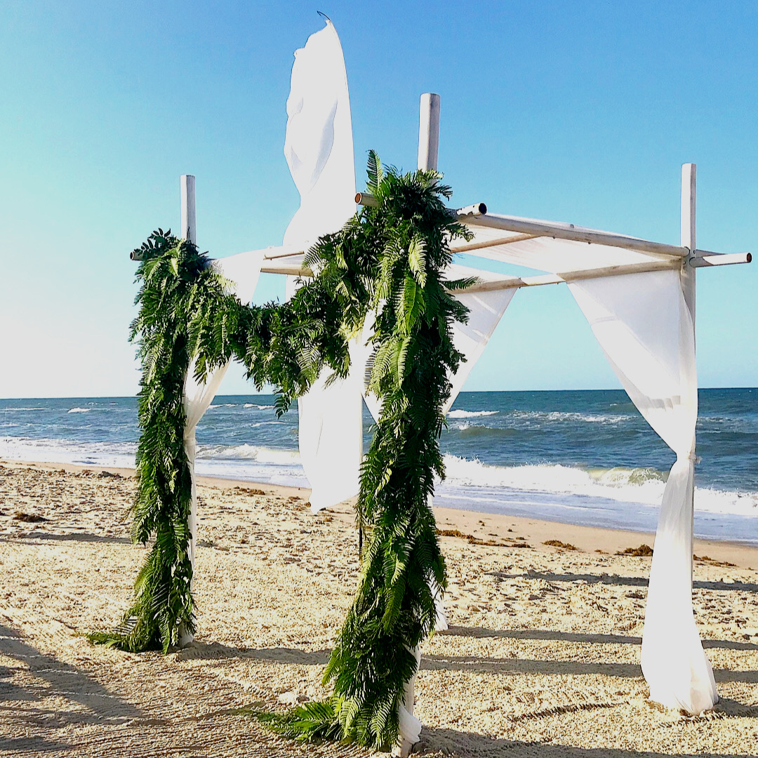 renee landry events arch arbor altar greenery fern garland outer banks beach wedding florals