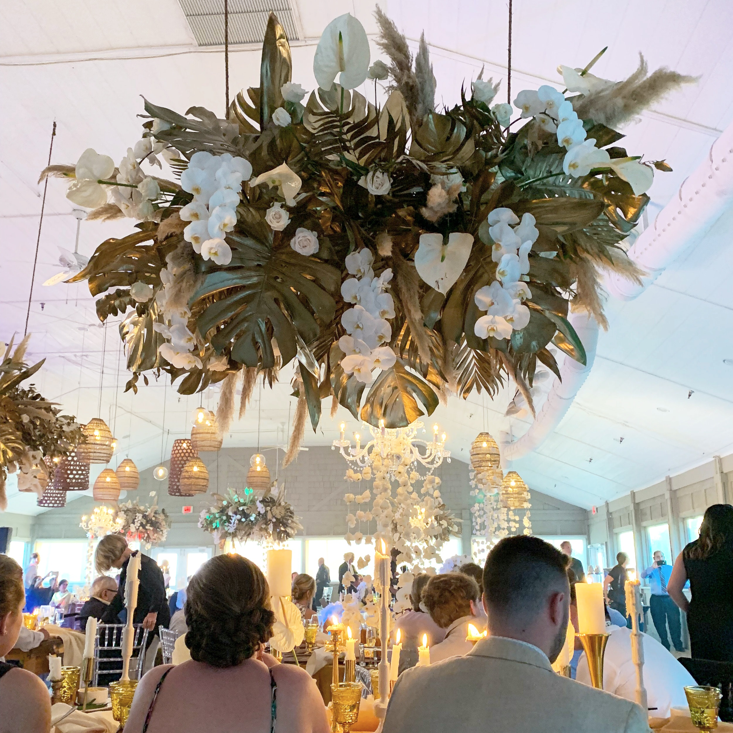 renee landry events outer banks boho green monsterra chandelier orchids tropical lush foliage gold leaf wedding floral rentals.jpg