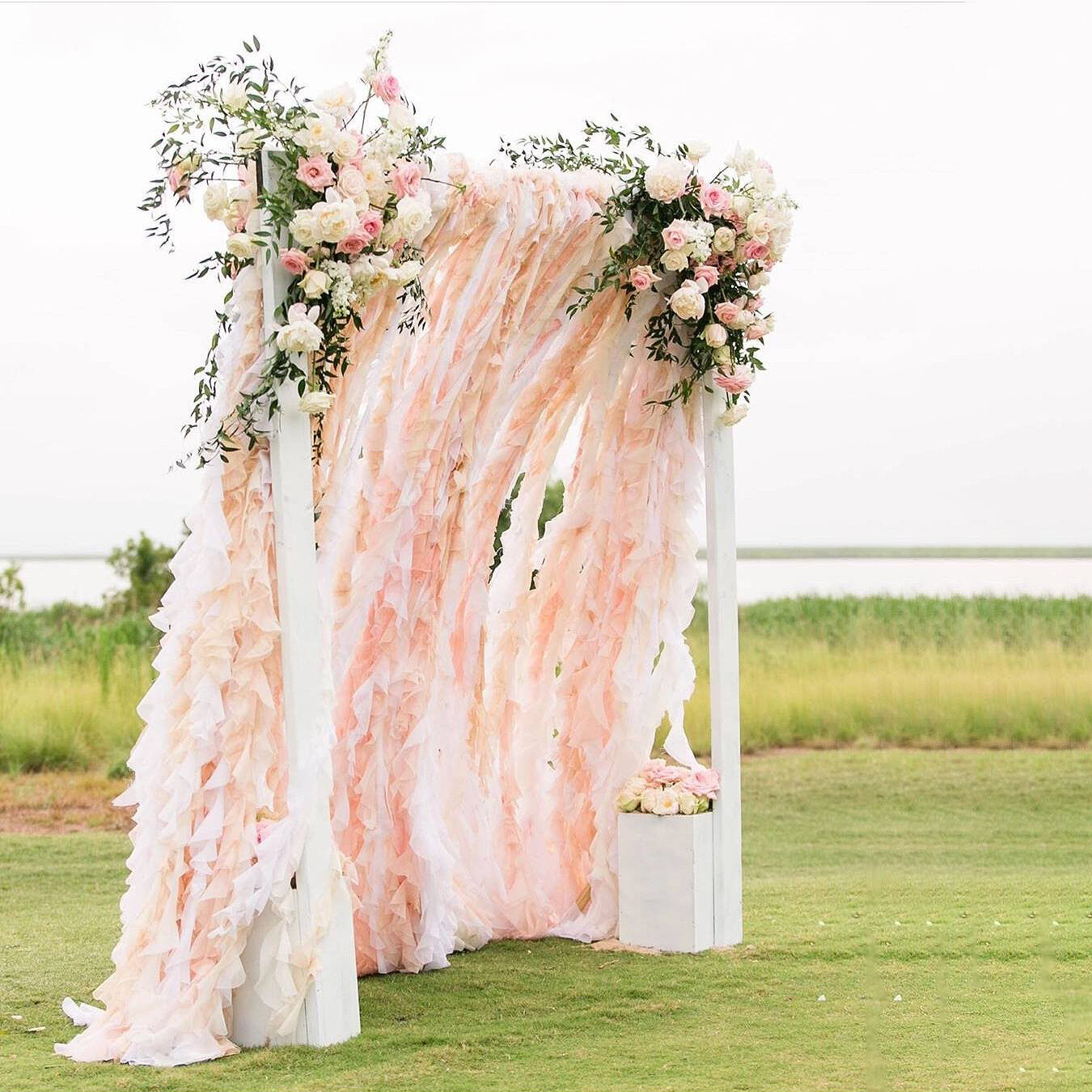 renee landry events outer banks wedding rentals backdrop fabric ruffles pink texture peekaboo.jpg
