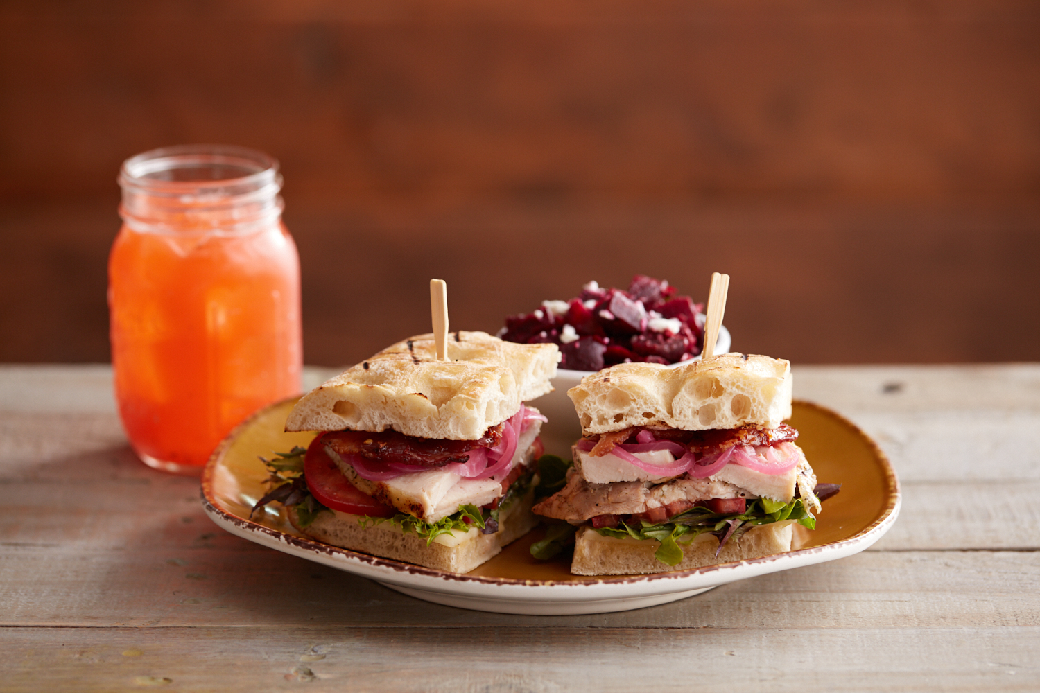 Kombucha on tap and grilled chicken sandwich on ciabatta bread with beet salad.