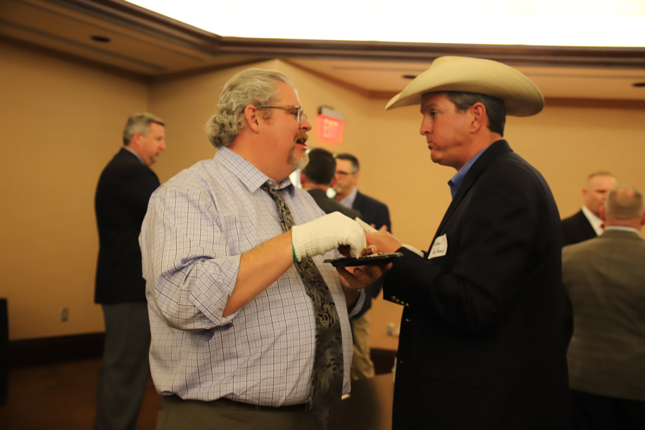 Roy Lee Lindsey and Michael Kelsey enjoy the pork tenderloin and beef prime rib at the legislative recpetion.