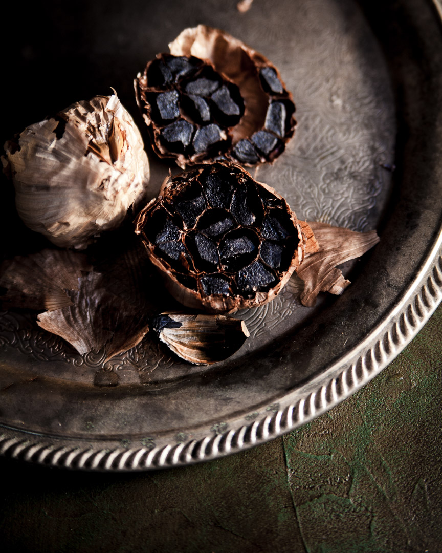 black garlic shot with moody background and light. Sarah Ehlinger / Brand Spanking You Brand Photography